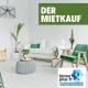 """Wohnzimmer mit Couch und Sessel , Pflanzen und der Überschrift """"Der Mietkauf"""""""