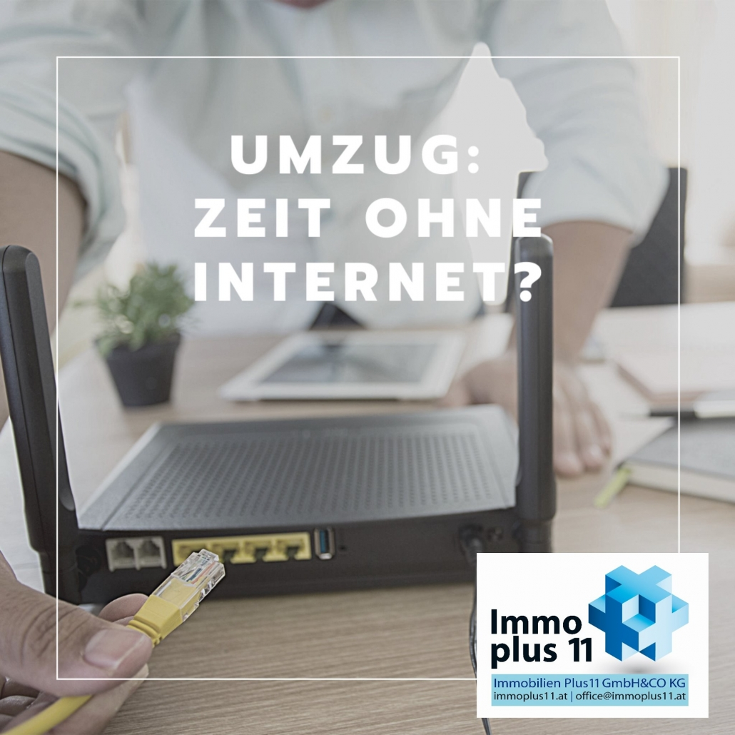 """Schreibtisch mit Internetrouter und Überschrift """"Umzug - Zeit ohne Internet"""""""